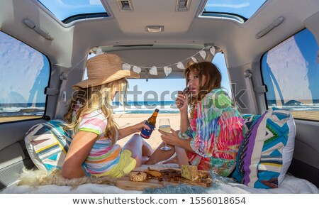 Two girls van life enjoy the beach summer  Stock photo © lovleah