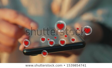 Woman hand browse popular content on smartphone screen. Close up Stock photo © lightkeeper