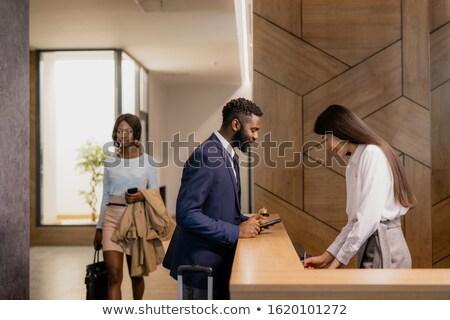 Fiatal afrikai üzletember görbület recepció pult Stock fotó © pressmaster