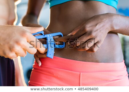 Man Measuring Fats With Caliper Stock photo © AndreyPopov