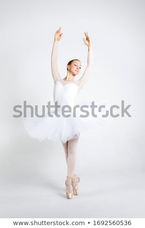 Young ballerina practising ballet moves Stock photo © boggy