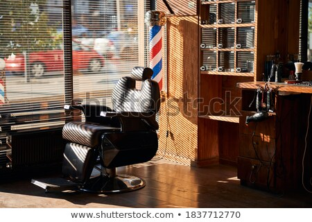 hair dryer on leather chair seat at barbershop Stock photo © dolgachov