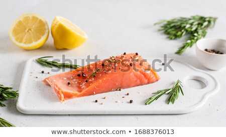 Raw uncooked trout with lemon Stock photo © furmanphoto