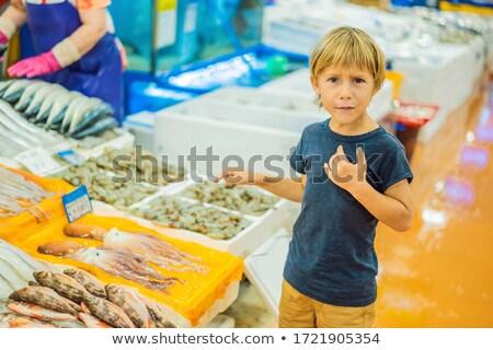 Boy in the Korean market. Raw seafood at Noryangjin Fisheries Wholesale Market in Seoul, South Korea Stock photo © galitskaya