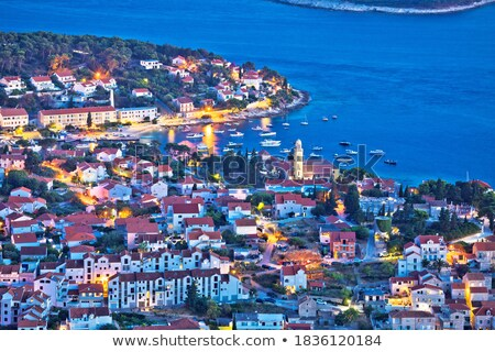 Island of Hvar town waterfront aerial evening view Stock photo © xbrchx