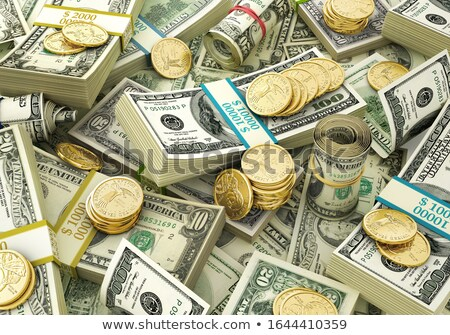close up view of the one dollar bill and some coins stock photo © johnkwan
