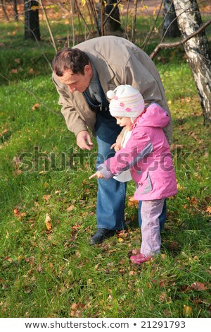 Grandfather with  granddaughter outdoor look downward Stock photo © Paha_L