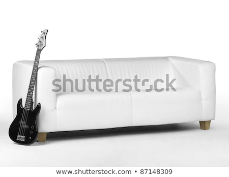 Black Bass Guitar And White Couch Photo stock © PRILL