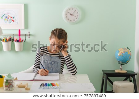 teenage student school girl talking mobile phone stock photo © darrinhenry