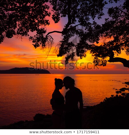 couple sunset profile back light in orange sea stock photo © lunamarina