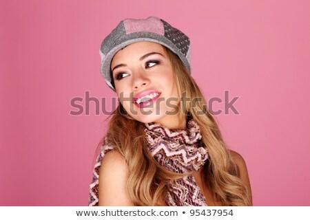 beautiful woman wearing winter cap looking over her shoulder Stock photo © Rob_Stark