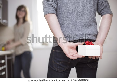 Man hiding gift behind back Stock photo © photography33
