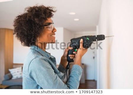 Portrait femme forage maison heureux travaux Photo stock © photography33