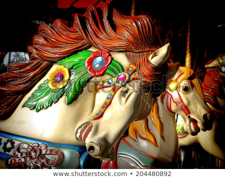 merry go round horse head stock photo © mybaitshop