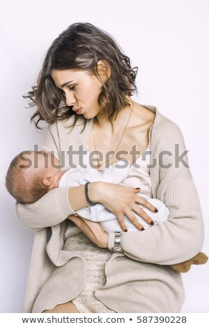 little girl crying in mothers arm isolated on white stock photo © dacasdo