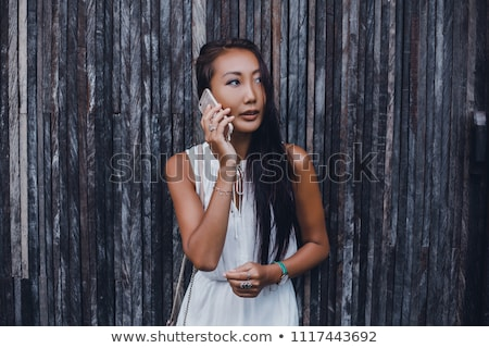 Portrait of a beautiful young businesswoman looking at the scree Stock photo © HASLOO