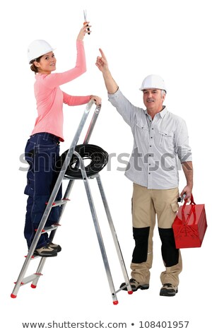 experienced tradesman pointing to his assistant stock photo © photography33