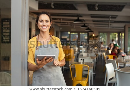 Waitress and clients in a restaurant Stock photo © photography33
