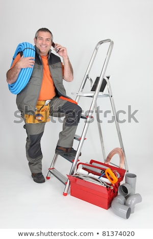 plumber on the phone next to stepladder with laptop Stock photo © photography33
