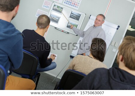 Male teacher stood at front of classroom Stock photo © photography33