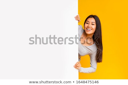 pretty girl holding blank board stock photo © stryjek
