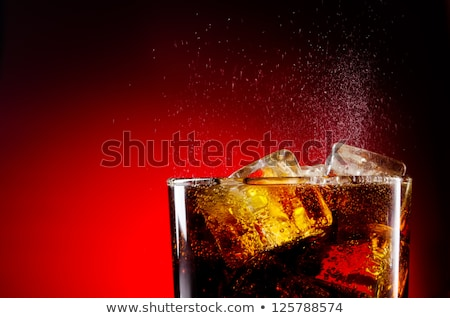 cola with ice   horizontal close up stock photo © bugstomper