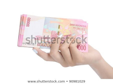 Woman hand with red nails offers dollars stock photo © Olesha