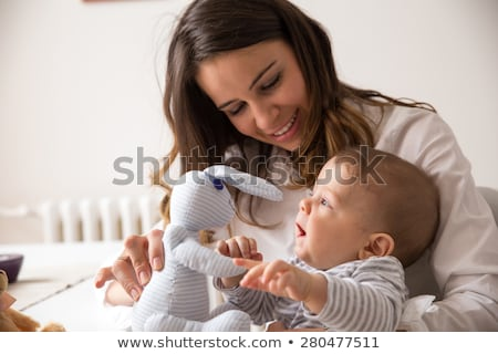 Baby And Mother Playing With The Toys Stock photo © leedsn