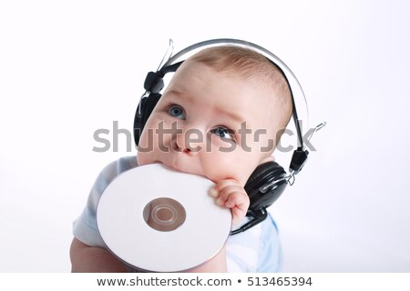 young child playing with CD Stock photo © gewoldi