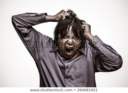 Man with his hands on his head shouting Stock photo © photography33