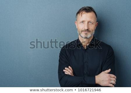 idősebb · férfi · pózol · keresztbe · tett · kar · teljes · alakos · portré - stock fotó © stockyimages