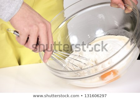 Mulher mistura tigela comida mão ovo Foto stock © photography33