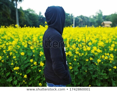 Stock photo: Boy stood in alone in field