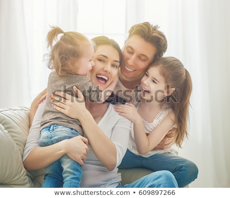 Happy family laughing faces Stock photo © Anna_Om