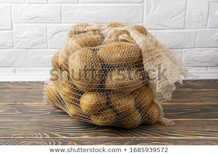 potatoes in a net Stock photo © prill