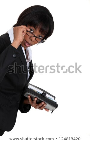 black businesswoman with lowered glasses holding agenda Stock photo © photography33