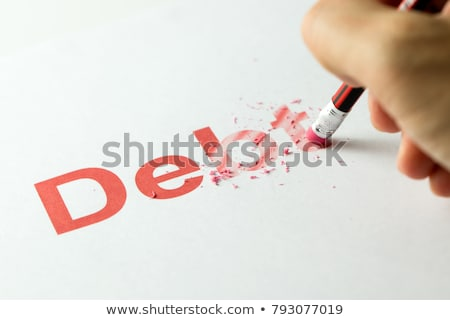Stock photo: eraser and word debt
