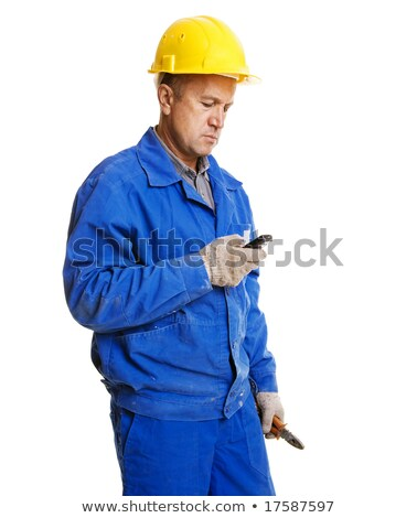 Tradesman with his mobile phone Stock photo © photography33