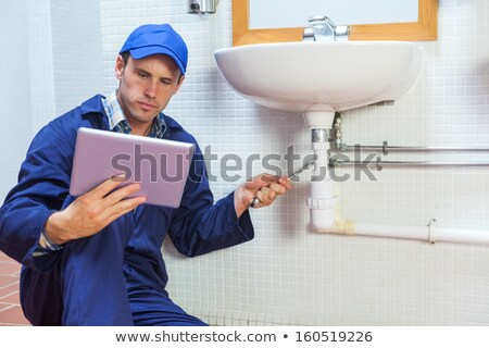 Man in Bathroom with Tablet PC Stock photo © lisafx