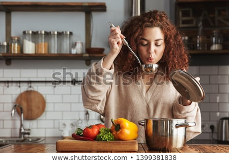 portrait of a woman cooking vegetables stock photo © adam121