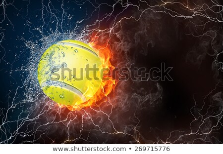 Tennis ball in fire flames and splashing water stock photo © Kesu