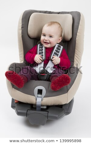Сток-фото: Toddler In Booster Seat For A Car In Light Background