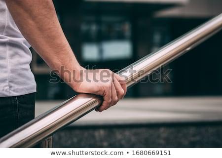 Boy leaning on railing. Stock photo © iofoto