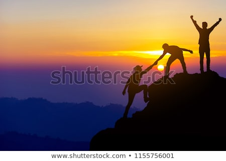 Couple hikers silhouette in mountains Stock photo © blasbike