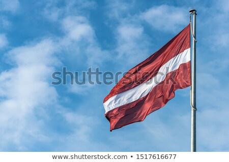 Bayrak Letonya rüzgâr bez topluluk tekstil Stok fotoğraf © joggi2002
