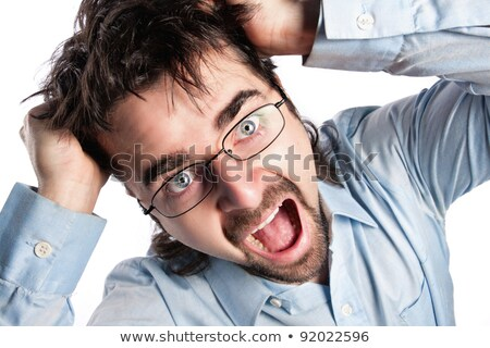 Man tearing out his hair in desperation Stock photo © smithore