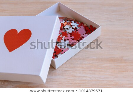 charity concept on red puzzle stock photo © tashatuvango