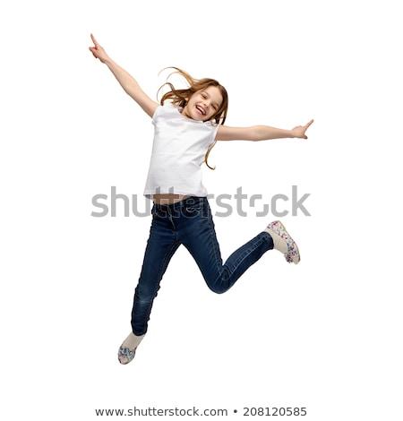 little beautiful girl fly jumping isolated on white stock photo © lunamarina