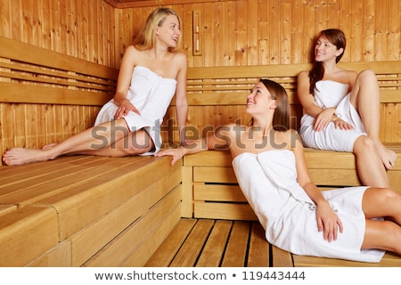 Three friends in sauna of a thermal bath stock photo © Kzenon