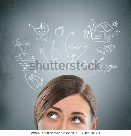 headshot of beautiful young woman thinking sketches with her to stock photo © hasloo